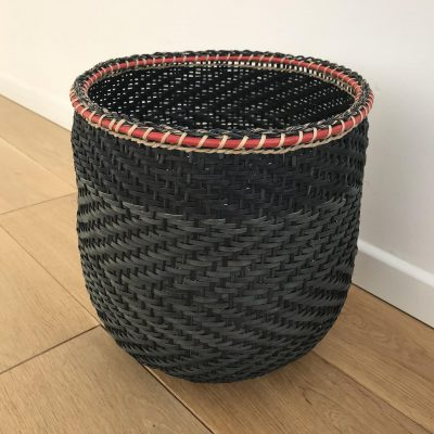 A black storage basket handmade in Colombia