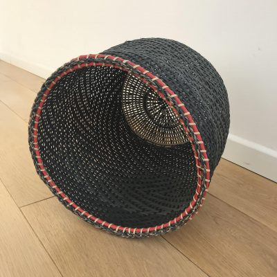 A black storage basket handwoven by Colombian native people