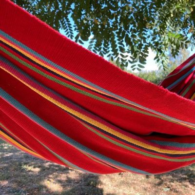 A bright red classic hammock handcrafted in Colombia
