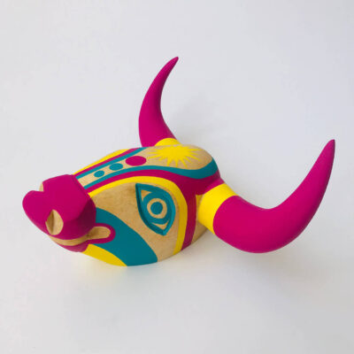 wooden carved bull head pink